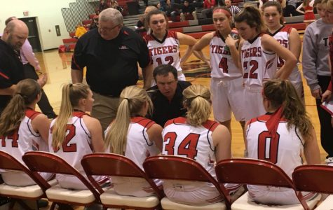 Coach Hansen talks to the girls team during a time out.