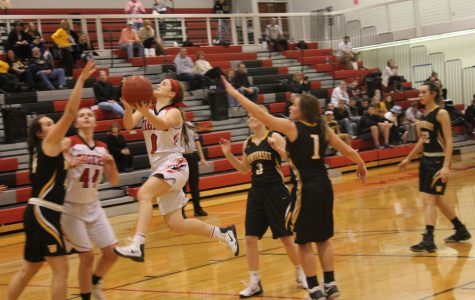Fighting for a win, Abby Hlas drives the ball in multiple times putting up double digits in points. With the score rounding out to be 57-54, ADM Tigers finally got the win they were looking for. They hope this win will take them on a