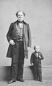 Barnum towering over one of his most famous performers, General Tom Thumb