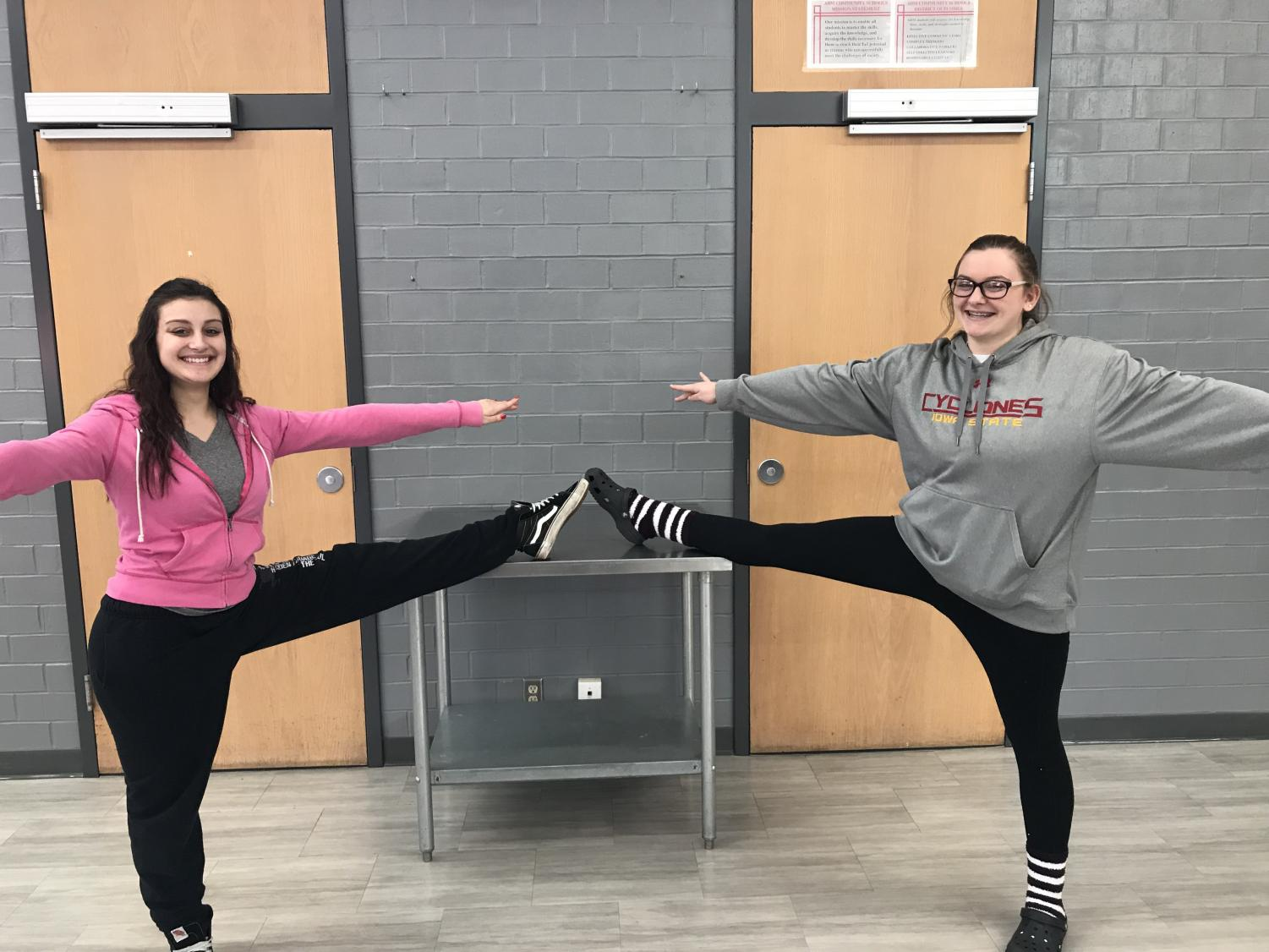 Katelyn, right, pictured with a fellow dancer, Alayah, left, after being named Dance Athlete of the Month.