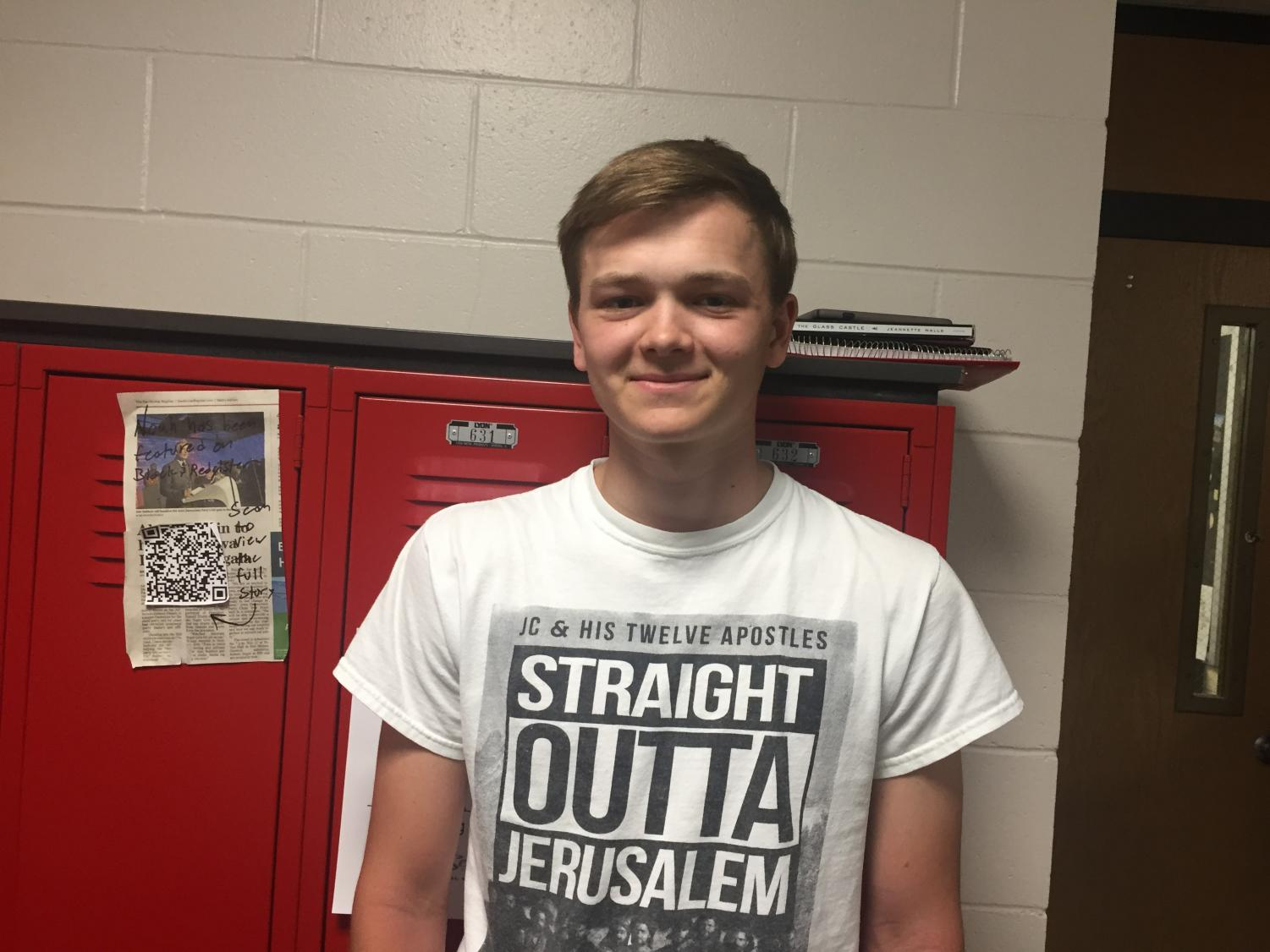 Adam O'Connor smiling for the camera after being told he was selected as March Student of the Month for Boys Golf.