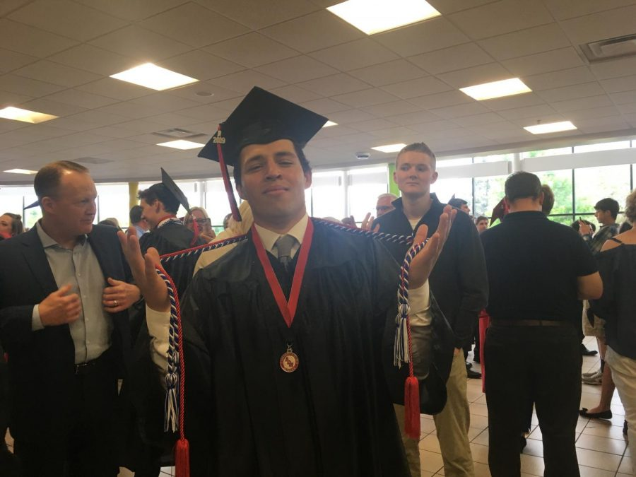 Joe Finnegan, May Golf Athlete of the Month, showing off his cords at graduation.