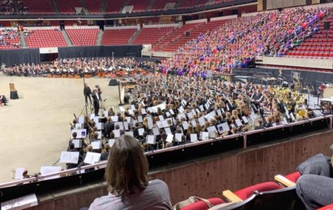 In front of thousands, four musicians preform in the All-state band/choir.