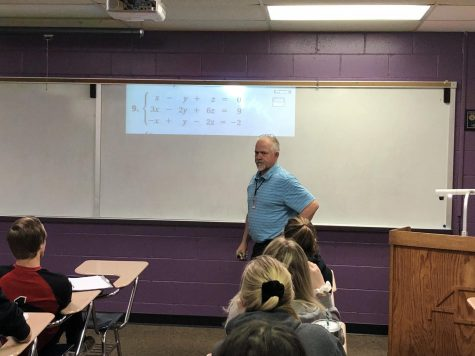 Cris Goodale calling on students during a math lesson to have the question on the board.