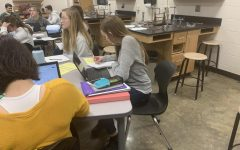 Hard at work, Amber Gehring is attending one of her many difficult classes: Physics. She is able to handle such classes with good study habits. Amber advices others to find a balance between school work and fun activities.