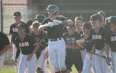 ADM's high school baseball team celebrates as they upset Harlan in the District Finals, sending them to the state tournament with a record of 13-17.