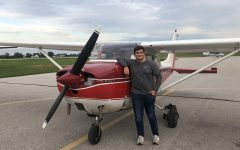 May Kiwanis Student of the Month, Nathaniel Aukes in his favorite place, the airport