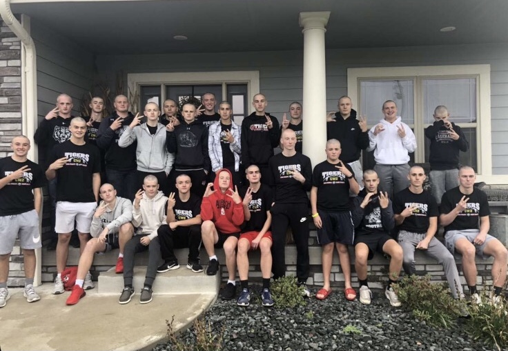 ADM Football Team at Cole Williamsons House on Tuesday October 20th posing for a picture after they shaved their heads.