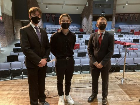 Brennan McGee, Cash Riker, and Sean Whitson, the three All-State choir musicians all posed in their suits after they finished their auditions. Days later, they learned that they all were accepted to the choir.