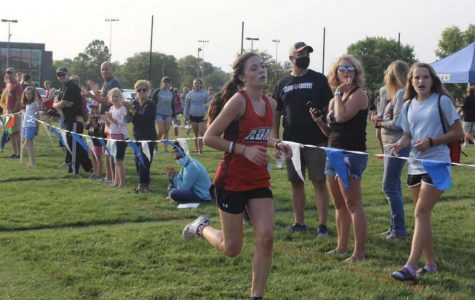 Geneva Timmerman (10th grade) runs at a cross country meet. Photo by Allison Poch.