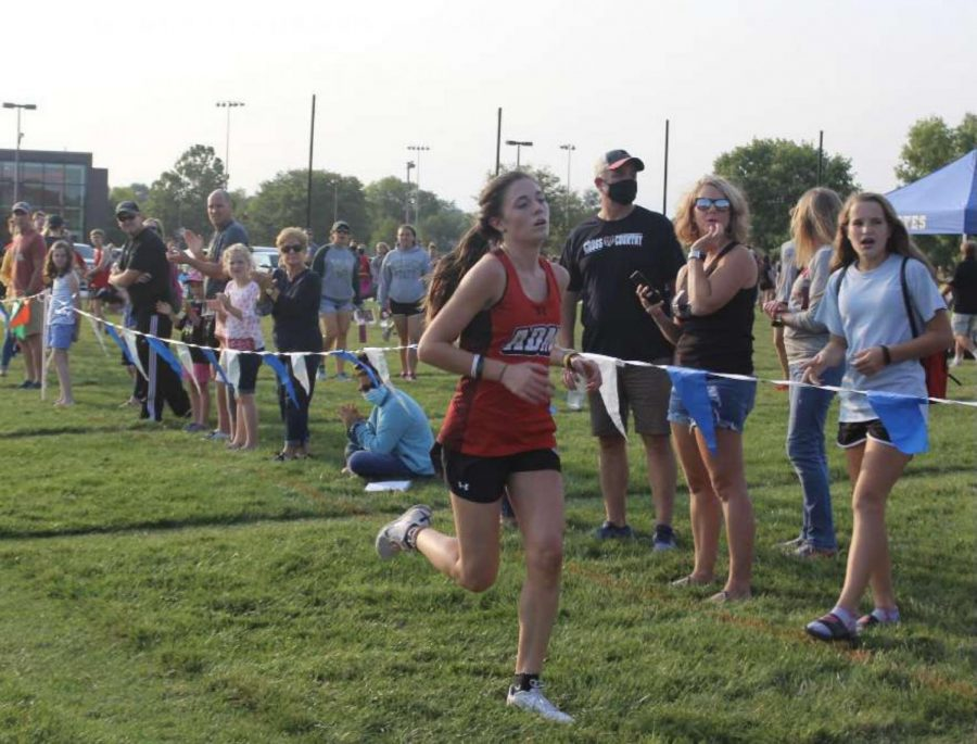 Geneva+Timmerman+%2810th+grade%29+runs+at+a+cross+country+meet.+Photo+by+Allison+Poch.