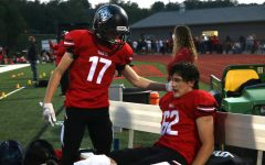 Sophomore Ben Smith (left) comforts Dallas Trigg (right) after Trigg fractured his tibia and fibula.