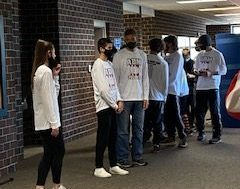 ADM XC runners lining up for recognition before State meet. Pictured by Haley Gonzalez.