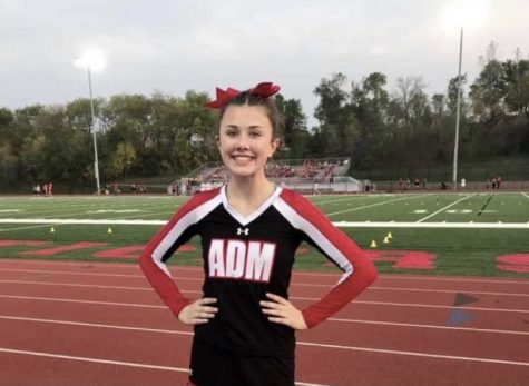 Alexa Teckenburg, cheering on the ADM football team at a home game.