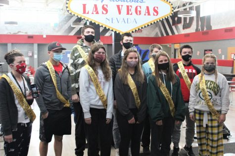 "The Homecoming Court stands in front of the ""Welcome to Las Vagas"" sign after being announced on Tuesday, January 19th. This was the start to one of the biggest controversies of the year, as the students that were selected were chosen by the teachers and not the students."