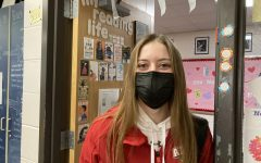 Beaming behind her mask, senior Aniston Smith stays during her open to complete her interview. She has been honored as one of the Kiwanis Students of the Month, which she believed is due to her applying herself more in school and activities.