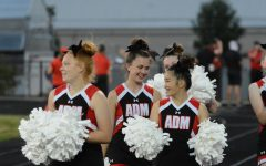 Pictured on the left, Avery Miller and the rest of her team get ready to cheer on ADM.