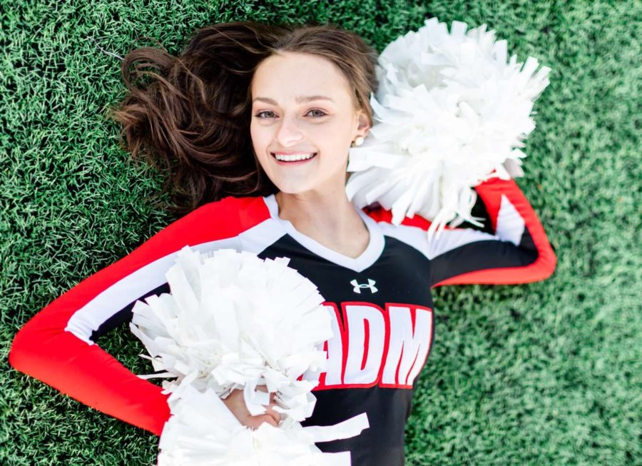 Senior, Hayley Owen in cheer uniform.