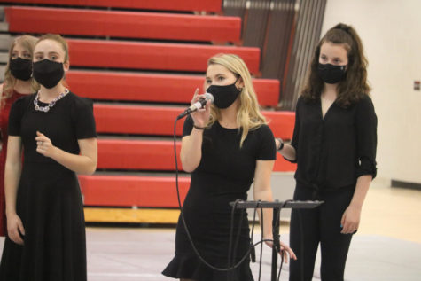 """Junior Callie Hazel performs her solo with the """"Good Vibes"""" Jazz Choir."""