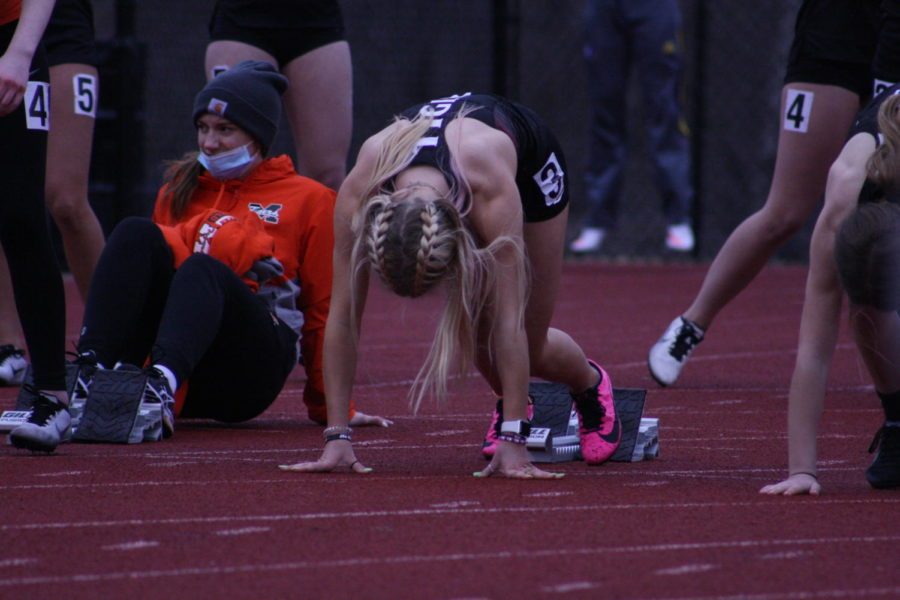 Lining up for the 100m dash, Junior Olivia Tollari gears up for her race. Tollari said,