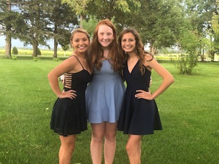 ADM 2019 Homecoming. Callie Hazel, pictured left, wearing a $30 dress from the clearance rack, Monica Thomas, middle, wearing a borrowed dress from upperclassman, Haley Gonzalez, right, wearing borrowed shoes, unpictured.