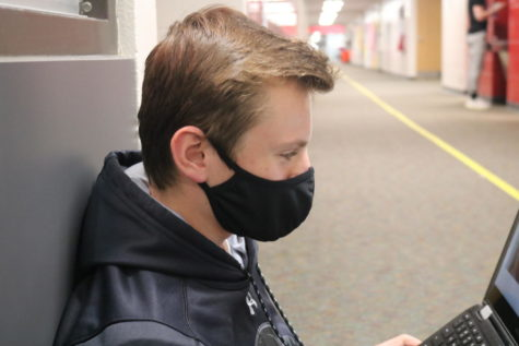 ADM sophomore student, John Hoben, wearing his mask in school.