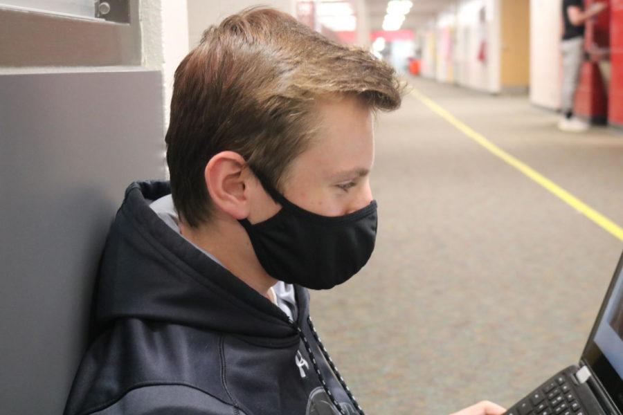 ADM sophomore student, John Hoben, wearing his mask in school.