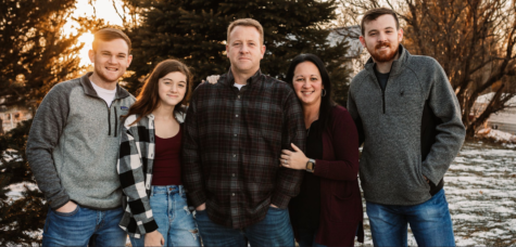 Mrs. Reed and her family posing for a family picture. If you need professional, high quality pictures look at more of her work on her website and follow her on Facebook @JRPhotography.