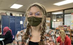 Sarena Gibson, May's Fine Arts Student of the Month, smiles beneath her mask in the News Room. She is among the final group of people to have been nominated for this honor this year.
