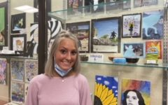 Osgood stands next to her artwork on display outside the Art room. She said, It is an honor to be recognized. Osgood and other senior artists are also featured on RRC All- Conference Senior Artists.