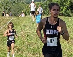 Kimrey running in a meet during his final XC season at ADM.