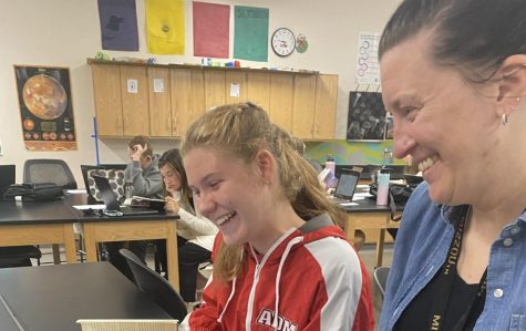 October's Teacher of the Month: Mrs. Knipper helping a student in her Science-English class